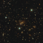 A massive cluster with possible quadruple lens