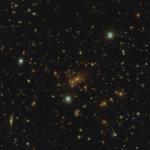 A massive cluster with possible quadruple lens