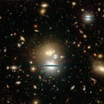 January 2017: Galaxies grow progressively more massive through mergers. Mergers can be quite violent and multiple galaxies may merge at one time to form a massive galaxy.