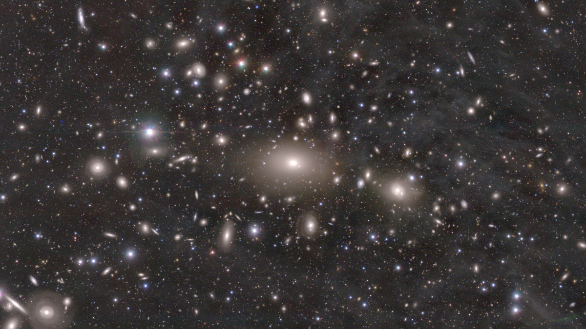 august 2020: A nearby, massive galaxy cluster. You may be able to see the diffuse cirrus extending over the cluster. This is gaseous nebular in the Milky Way Galaxy and it reminds us that we are observing the distant Universe through our own Galaxy.
