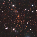 December 2020: a righ galaxy cluster located at 0.7 (approximately 6.5 billion years ago). The cluster is dominated by red galaxies and there are few blue (=star forming) galaxies.