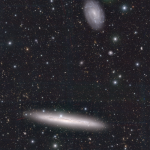 November 2020: NGC4517, a nearby edge-on disk galaxy located at 9Mpc from us. The galaxy on the top is a companion galaxy.